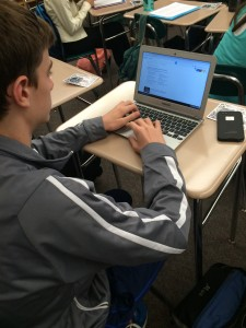 Max Geeting a sophomore at HHS works on his English project in Crowley's class during first period on Friday, Oct. 2, 2015. Everyone in class that day had to work on a project about dystopian society. Students had a choice of using technology or working on a poster.