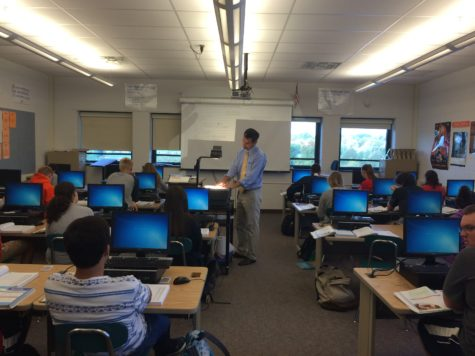 Gustantino, center, teaches his Accounting l class about how to put information into a General Journal Wednesday, Oct. 7, 2015. He presented the answers to the worksheet using the projector for the convenience of students.