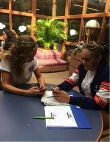 Bella D'Adderio, right, sophomore at HHS and Burston-Green, left, are in the library at HHS  Friday, Sep. 25, 2015. D'Adderio helped Burston-Green make online flashcards of her Acedemic Literacy vocab list.