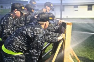 The Constellation Division Cadets participate in a simulation on June 11, 2015. In this simulation, the cadets were working together to plug holes in the wall with rubber for teamwork.