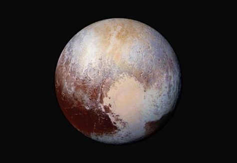 FILE - This image made available by NASA on Friday, July 24, 2015 shows a combination of images captured by the New Horizons spacecraft with enhanced colors to show differences in the composition and texture of Pluto's surface. The images were taken when the spacecraft was 280,000 miles (450,000 kilometers) away. The New Horizons was programmed to fire its thrusters Thursday, Oct. 22, 2015, putting it on track to fly past a recently discovered, less than 30-mile-wide object out on the solar system frontier. The close encounter with 2014 MU69 would occur in 2019. It orbits nearly 1 billion miles beyond Pluto. (NASA/JHUAPL/SwRI via AP)