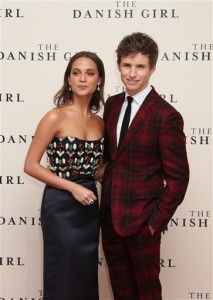 Alicia Vikander, left, and Eddie Redmayne pose for photographers upon arrival at the premiere of the film 'The Danish Girl' in London, Tuesday, Dec. 8, 2015. (Photo by Joel Ryan/Invision/AP)
