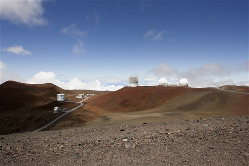 From bottom left, the Caltech Submillimeter Observatory, James Clerk Maxwell Telescope, the Submillimeter Array, the Subaru Telescope and the Keck Observatory telescopes are shown on Hawaii's Mauna Kea, Monday, Aug. 31, 2015, near Hilo, Hawaii. (AP Photo/Caleb Jones)