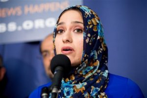 Muslim Public Affairs Council Media and Communications Director Rabiah Ahmed speaks at a press conference held by the U.S. Council of Muslim Organizations at the National Press Club in Washington, Monday, Dec. 21, 2015, to announce 'major initiatives to address growing islamophobia in America and to enhance national security' speaks at a press conference. (AP Photo/Andrew Harnik)