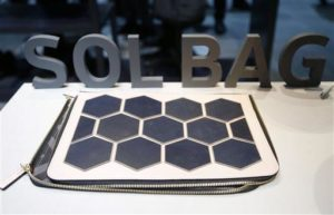 The Sol Bag solar power charger and handbag is on display at the Samsung booth during CES International, Friday, Jan. 8, 2016, in Las Vegas. (AP Photo/Gregory Bull)