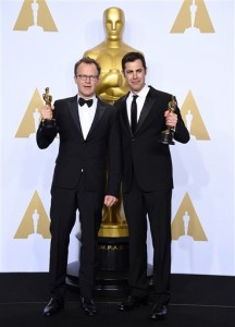 """Tom McCarthy, left, and Josh Singer pose with the award for best original screenplay for """"Spotlight"""" in the press room at the Oscars on Sunday, Feb. 28, 2016, at the Dolby Theatre in Los Angeles. (Photo by Jordan Strauss/Invision/AP)"""