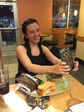 Palutis poses for a snapchat at Panera Bread in Hummelstown on Wednesday, January 27, 2016. Palutis feels frustrated when people open her snapchats and do not reply.