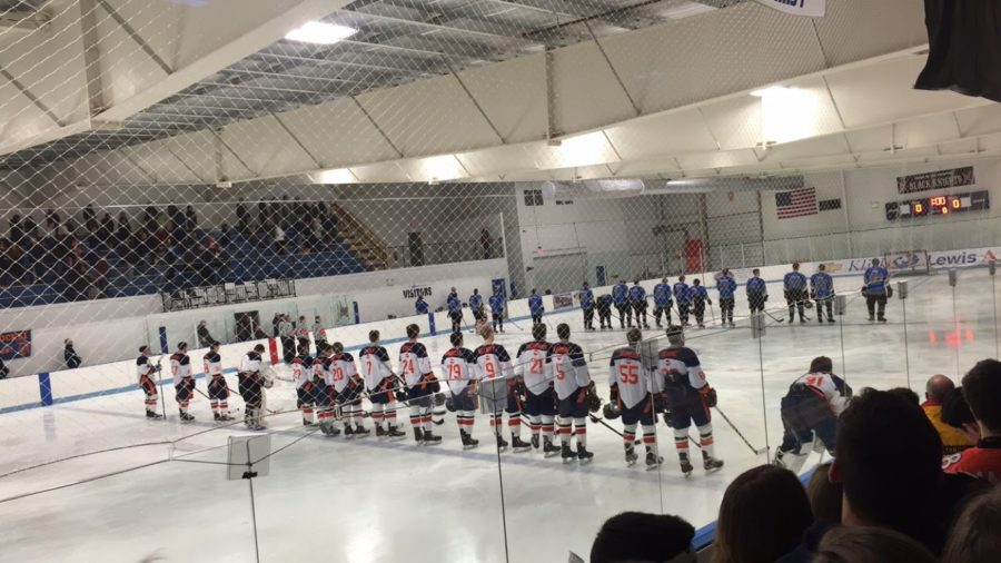 Hershey Trojans and Cedar Crest Falcons stand and listen to the National Anthem before the puck drop. The Trojans beat the Falcons 4-2 on Friday, February 26, 2016.