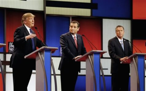 In this March 3, 2016 file photo, Republican presidential candidates, businessman Donald Trump, Sen. Ted Cruz, R-Texas, and Ohio Gov. John Kasich appear during a Republican presidential primary debate at the Fox Theatre in Detroit. Michigan Republicans meet Saturday, April 9, in Lansing for their annual convention with one of the main agenda items the choosing of delegates to the party's presidential convention in July in Cleveland. (AP Photo/Paul Sancya)