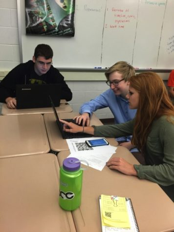 From left to right: Junior Colin Sheehan, Junior David Sheffey, and Sophomore Grace Murray prepare for their next session on Friday, April 29th, 2016. Their first student-run session was a success. (Broadcaster/ Irene Ciocirlan)