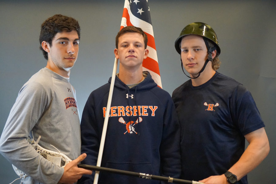 Seniors John Sickler, Matt Brier, and Karl Van Blargan show their love for their country by posing with the American Flag and Army helmet. The seniors have lead the Boys Lacrosse team to a 12-4 record. (Broadcaster/Kieran Holley)