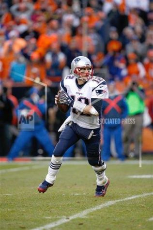 Patriots quarterback Tom Brady looks for an open receiver during a playoff game against the Denver Broncos, on January 24, 2016. Brady was recently suspended for the first four games of the 2016 NFL season. (AP Images)