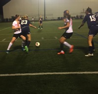Cassie Zugay(23) and Mikala Awde(15) work together to get the ball. Hershey received the ball off of Zugay's pass, and Hannah Jones attempted to score.  (Broadcaster/Shyanne Gaston)