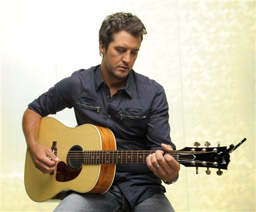 """In this July 12, 2011 photo, country music artist Luke Bryan poses for a photo in Nashville, Tenn. Bryan released his third album """"Tailgates and Tanlines,"""" (AP Photo/Donn Jones)"""