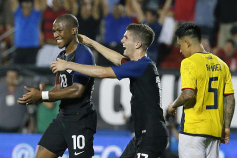 United States' Darlington Nagbe (10) and Christian Pulisic, center, celebrate Nagbe's goal in front of Ecuador's Cristian Ramirez (5) during the second half of an exhibition soccer match, Wednesday, May 25, 2016, in Frisco, Texas. The United States won 1-0. (AP Photo/Tony Gutierrez)