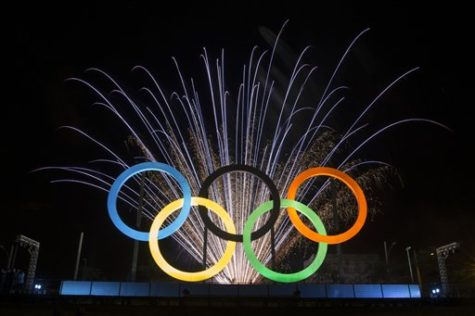 Fireworks explode behind the Olympic rings during their inauguration at the Madureira Park in Rio de Janeiro, Brazil, Wednesday, May 20, 2015. The rings are a gift from the city of London. (AP Photo/Felipe Dana)