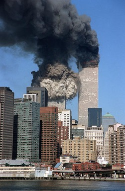 The south tower collapses as smoke billows from both towers of the World Trade Center, in New York, Tuesday, Sept. 11, 2001. In one of the most horrifying attacks ever against the United States, terrorists crashed two airliners into the World Trade Center in a deadly series of blows that brought down the twin 110-story towers. (AP Photo/Jim Collins)