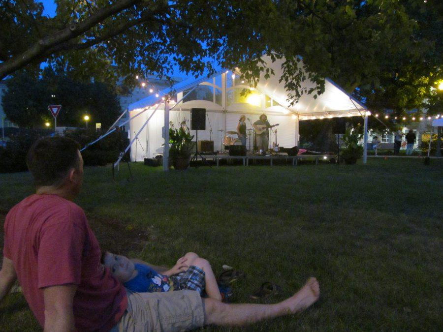 Locals relax on the grass as Sweet Corn and Peanut performs at Music on Chocolate on September 10. Sweet Corn and Peanut played a variety of acoustic pieces, ranging from cover to original songs. (Broadcaster/Cara McErlean)