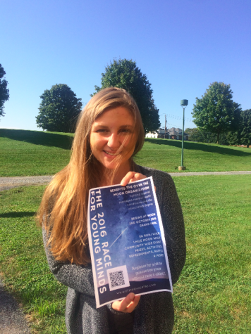 On September 23, 2016, HHS senior Rachael Schirato poses with a flier for the Race for Young Minds at HHS. Schirato, with the help of many others, organized this walk to benefit her mental health awareness non-profit, the Over the Moon Foundation. (Cara McErlean/ Broadcaster)