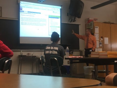 """Derry Township School District Superintendent Joseph McFarland presents a powerpoint to students during the community day session """"Local Politics: Getting to know your School Board"""" on October 7, 2016. The session was part of HHS' community day. (Broadcaster/Joel Neuschwander)"""