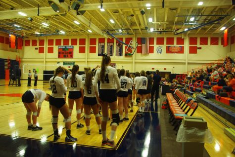 The Hershey High Girls Volleyball team prepares to face off against Mechanicsburg  in a home game on September 20th, 2016. The Trojans edged out a 3-1 victory for their fifth game of the season, ending the match with a 3-2 overall record. (Broadcaster/Omer Qureshi)