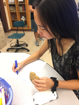 On Friday, October 7th, 2016.  HHS Junior, Laney Herndon  enjoys a snack from the session while writing her letter to a veteran. Herndon decided later to join Key Club for the remainder of the year. (Molly Glus/ Broadcaster)