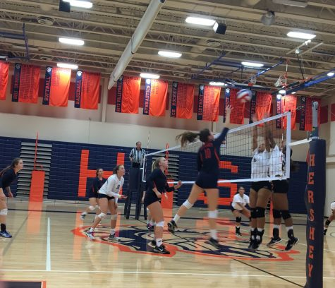 Hershey High School senior, Ali Gmerek, hits a ball set to her by HHS freshman, Annie Shay. The hit helped lead the Trojans to victory over the Milton Hershey Spartans. (The Broadcaster/ Emily Liesch)