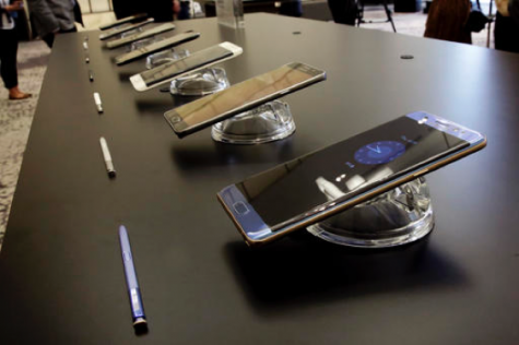 In this July 28, 2016, file photo, the Galaxy Note 7, foreground, is displayed in New York. U.S. regulators issued an official recall of Samsung's Galaxy Note 7 phone on Thursday, Sept. 15, 2016, because of a risk of fire. (AP Photo/Richard Drew, File)