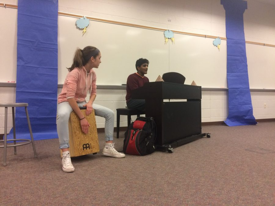 """Junior Audrey Stinson (left) and Matthew Abraham (right) duet in the song """"Car Radio"""" by twentyone pilots on Nexus Open Mic Night in the HHS LGI. Both have been very interested in music, with Stinson playing the drums and Abraham singing, playing the piano, and more. (Broadcaster/Jenny Kim)"""