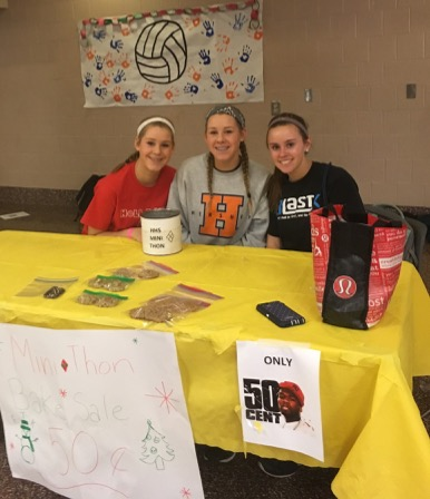 Sophomores Mayah Nicholson, Micah Nicholson, and Katie Cocco are selling backed goods for mini-THON during the volleyball tournament on December 22, 2016. The baked goods were 50 cents a piece. (Broadcaster/Kieri Karpa)