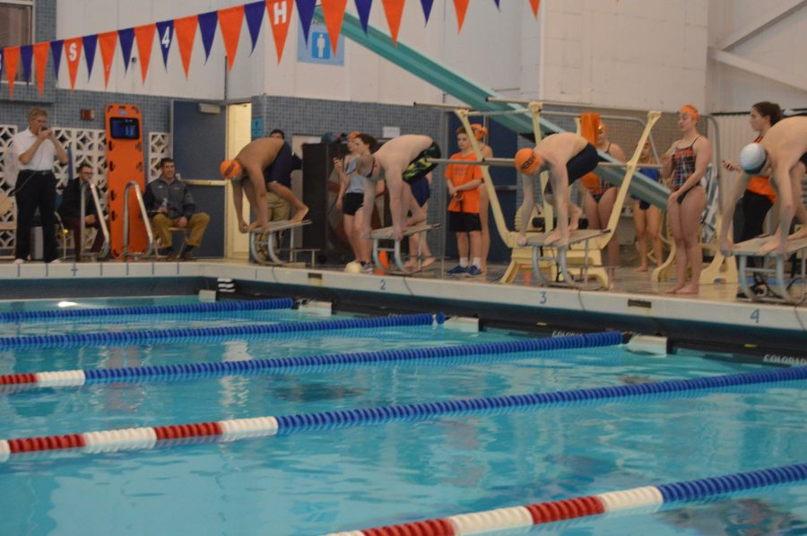 Hershey and CD East swimmers prepare to dive into the water before the 100 Free race. Hershey went on to beat CD East on January 24, 2017 at the Hershey Rec Center. (Broadcaster/ Lynn Dang)