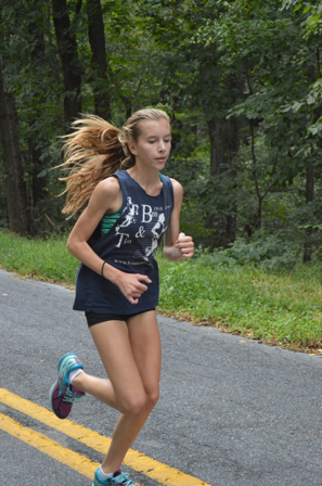 Faith Mark, sophomore, prepares for an upcoming meet early in the cross country season. Mark ran at Peffley Hills to build endurance and stronger leg muscles for the season ahead. (Broadcaster/Robert Sterner)