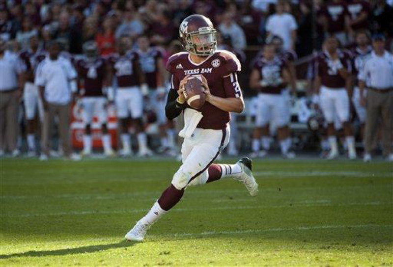 On Nov. 17, 2012, Texas A&M's Johnny Manziel rolls out to throw a touchdown pass during the first quarter of an NCAA college football game against Sam Houston State in College Station, Texas. Manziel became the first freshman to win the Heisman Trophy when the award was presented the next Saturday night. (AP Photo/Dave Einsel, File)