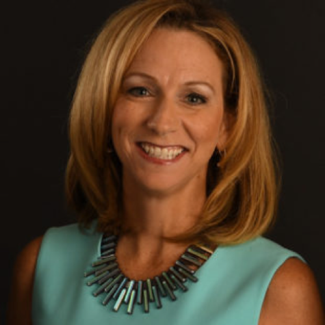 Beth Mowins poses for a picture for the ESPN Media Zone Biography page. Mowins was recently named the first female to play-by-play announce a nationally televised NFL game. (ESPN Media Zone)