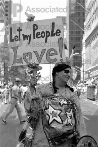 One of 50,000 marchers carries a sign during New York's annual Gay Pride Day parade, June 28, 1981. The parade, which commemorated the 12th anniversary of the Stonewall riot, moved up Fifth Avenue to a rally in Central Park. (AP Photo/G. Paul Burnett)