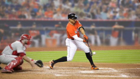 Giancarlo Stanton swings for the fences in a 2015 game against the division rival Phillies. Despite Stanton's home run, the Marlins lost the game 7-3. (Corn Farmer via Flickr/CC BY-ND Gian2.0)