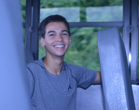Michael Cronin, ninth grade, ecstatic to get a break from his normal daily soccer practice from three to five, rides the bus home after school. Cronin spends an average of two hours working on homework each night. (Broadcaster/Claire Strucko)