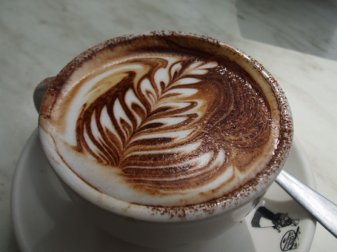 "Here shown is a cappuccino with a ""trendy"" design made within the foam. Coffee ""art"" is a growing trend in metropolitan areas. (Vivian Evans/ CC BY-SA 2.0)"