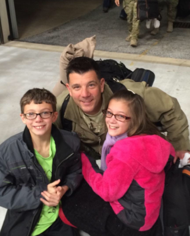 Barber with his two children. Barber said the hardest part of Military service is over the past 15 years, he's missed a total of three years of his children's lives. (Submitted by: Erik Barber)