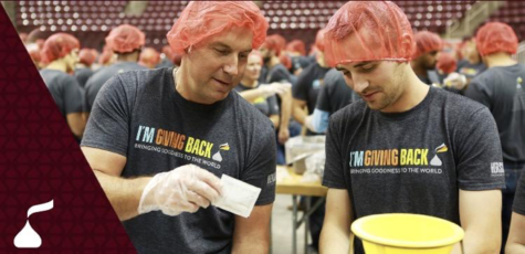 "The Hershey Company employees wear their signature ""I'm Giving Back"" shirts while volunteering. The volunteers worked together in the Giant Center to to promote their holiday campaign. (The Hershey Company)"