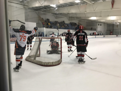 The Hershey Trojans celebrate a goal against Cumberland Valley on December 1 at Klick Lewis Arena. The Trojans won by 9 goals against CV to put them at 7 wins, 1 tie, and 2 losses. (Broadcaster/Elaina Joyner)