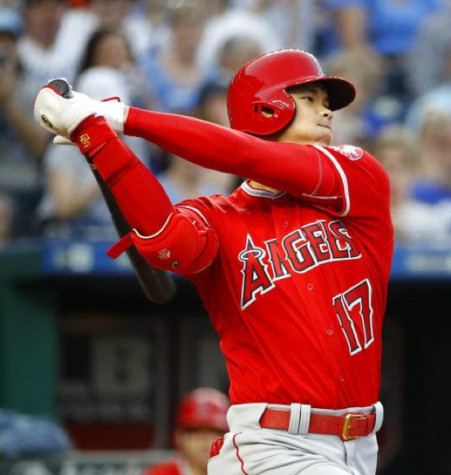 Shohei Ohtani hits a bases loaded triple against the Kansas City Royals. The Angels won the game 7-1. (Charlie Riedel/Associated Press)