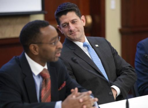 Speaker of the House Paul Ryan, R-Wis.,listens to Elroy Sailor, an executive focused on GOP outreach to the African American community. Ryan announced Wednesday April 11, 2018 he would not run for re-election this fall. (AP Photo/J. Scott Applewhite)
