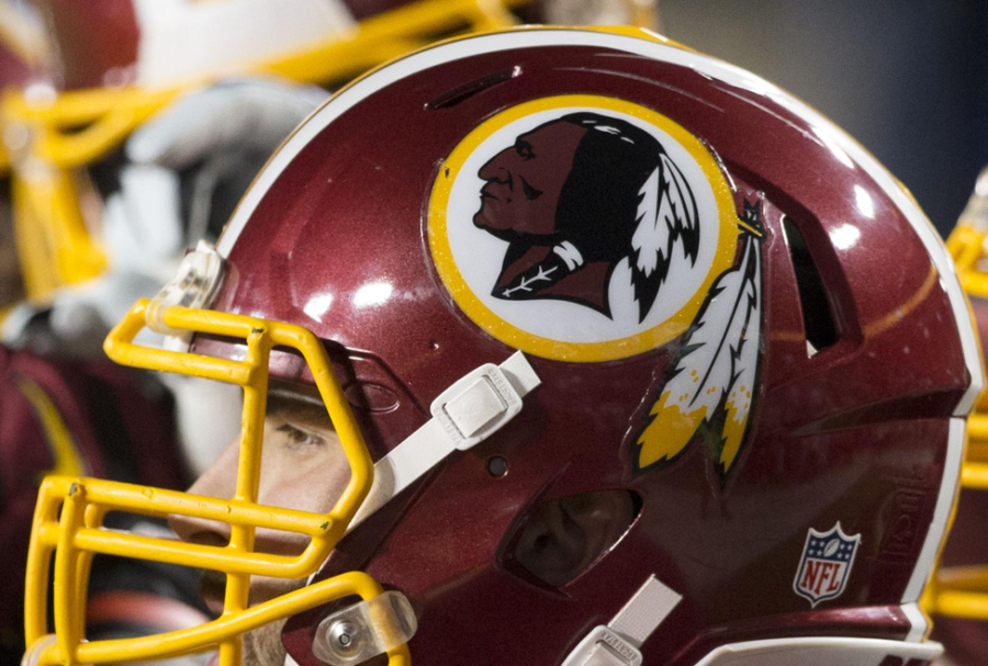 Washington Redskins helmet is worn by team quarterback, Kevin Hogan. Showing off the Redskins logo, team owner Daniel Snyder went to the Supreme Court on June 19, 2017, for complaints about the racist logo and name. (Keith Allison /CC BY-SA 2.0)