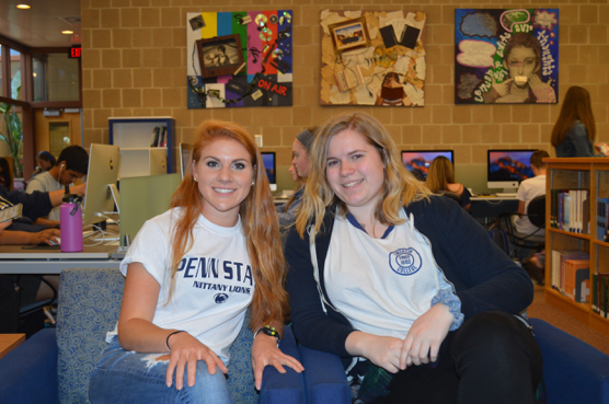 Grace+Murray+and+Molly+Reeves%2C+HHS+seniors%2C+show+off+their+college+t-shirts.+Murray+is+going+to+Penn+State+University+and+Reeves+is+going+to+Emerson+College.+%28Broadcaster%2FClaire+Sheppard%29