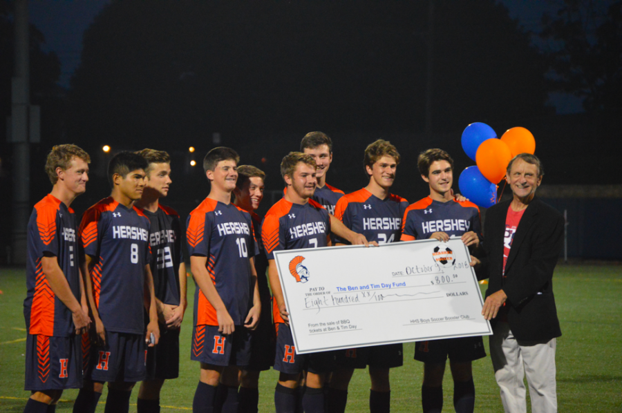 The HHS Boys Soccer Seniors present a check to the Ben and Tim Day Fund. The soccer team raised $800 by selling BBQ tickets and donated the proceeds to the charity. (Broadcaster/Emma Quillen)