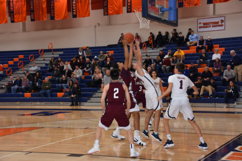 HHS senior Ben Hand shoots the ball into the net. The Trojans play again at home on Friday, December 14, 2018. (Broadcaster/Kate Clark)