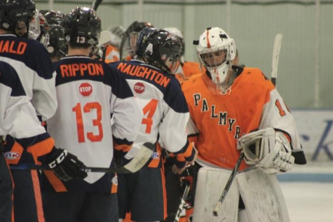 Trojans players shake hands with The Cougars goalie after the game. The Trojans will take the ice again Monday, February 25 at Klick Lewis fighting for a spot in the Bears Cup. (Submitted by Jason Rippon)