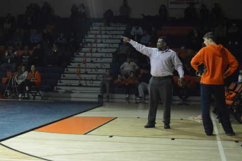 New Hershey Wrestling coach Dee Evans yells out helpful tips for his wrestler during a match against Red Land on January 10th 2019. The Trojans squeaked out a victory during this very close match by a score of 35-34.