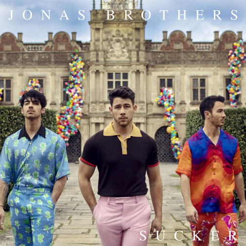 "The Jonas Brothers pose in front of the the Hatfield House for their ""Sucker"" album cover. The single is now rising on the top charts. (Sucker Album Cover)"